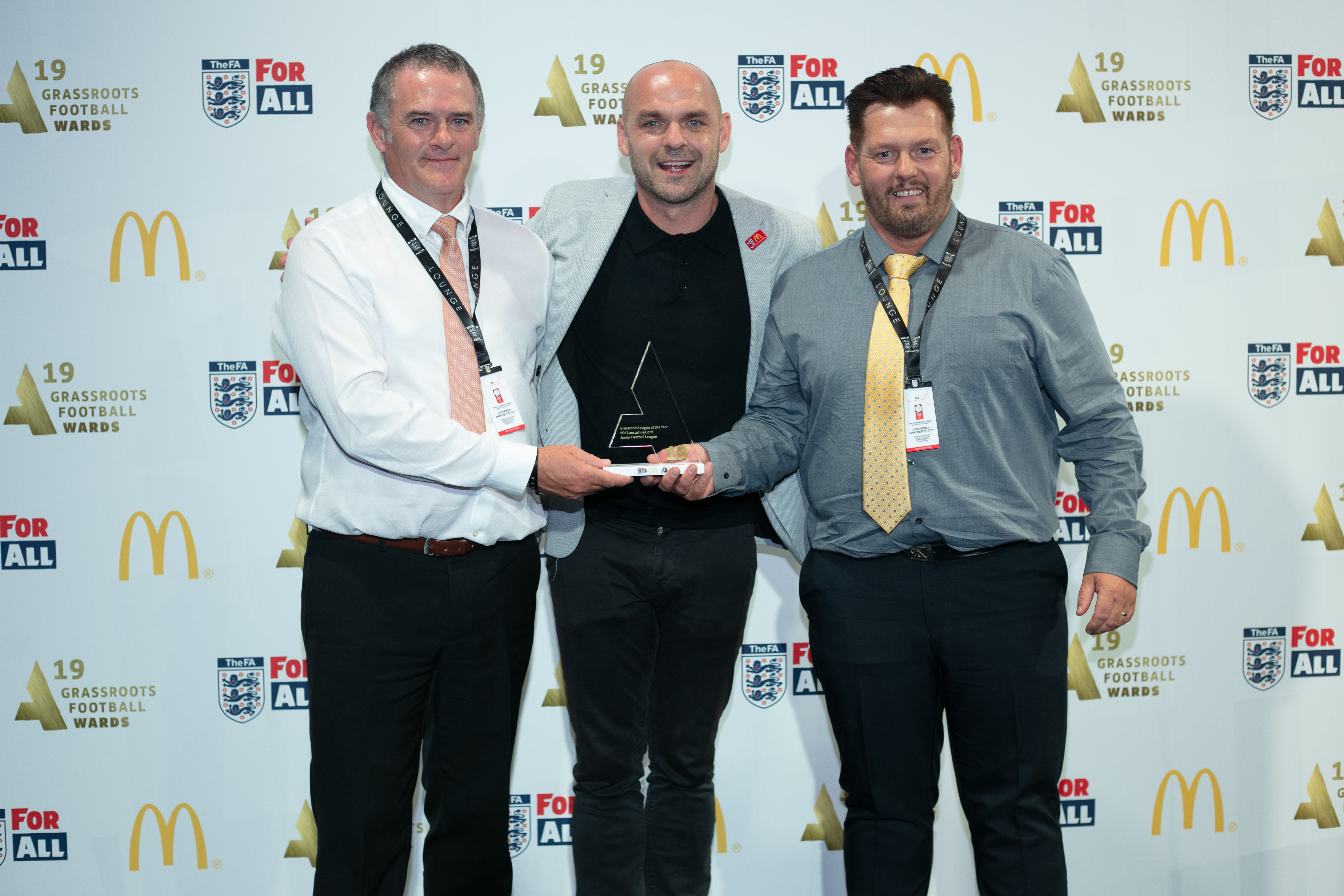 League Secretary Ian Christopher (Left) and Kevin Kealey (Right) receiving the award from Danny Murphy